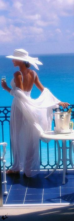 This reminds me of a movie from the 80's or 90's about a woman who travels to Europe and is staying near the Mediterranean Sea. She is overlooking the sea while enjoying her white wine.