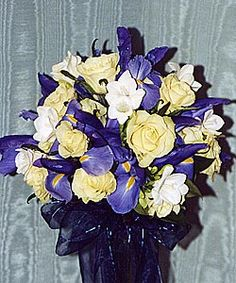 Might be better match w/ beige-ish gold table toppers; like dark ribbon tie on vase