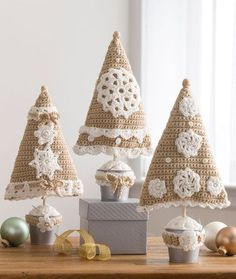 Triangle Christmas Trees  Or how about these little cuties? Christmas is coming! Designed by Sharon Mann for Red Heart Yarn.  Free pattern via Red Heart