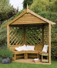 Or even this small corner pergola with a stationary bench in the back left corner of the yard would be good