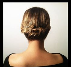 Elegant Updo for Short Hair - Renewed Style-- Here is an elegant updo for women with short hair. First, take the entire left side and start twisting near your ear. Then loosen it up after you pin everything.