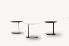 These fun, easy and versitile side tables come in Carrera Marble, Tabacco, and Black Walnut on a cast steel base.  23x17x20