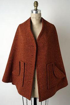 Cape  Designer: Claire McCardell  Manufacturer: Townley Frocks  Date: fall/winter 1947–48 Culture: American Medium: wool Accession Number: 1986.368