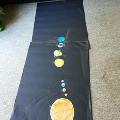 The Solar System on pegs 'recycled' into the Solar System on black sugar paper. Dwarf planet Pluto is way back, furthest from the Sun (small orange disc). I will now take close up of Pluto!
