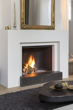 Fireplaces and fireplace mantels are fast becoming a core feature in homes across the world as they add a real feature point to any formal or indeed casual living area. Funnily enough fireplaces ha… Fireplace Box, Tv Above Fireplace, Fireplace Remodel, Fireplace Surrounds, Fireplace Design, Modern Fireplace Mantles, Slate Fireplace Surround, Interior Exterior, Interior Design
