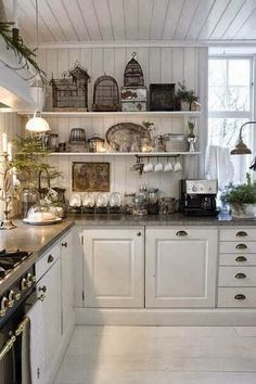 simply vintageous...beautiful white - Love the birdcages!