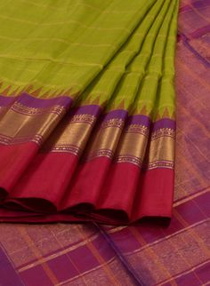 Venkie Reddy Handwoven Gadwal Silk Sarees with Checks & Temple Border. Saree has zari checks all over the body designed by Venkie Reddy.