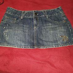 Fleur-de-lis Jean Skirt Awesome condition, never worn Jean skirt! Features metal details on back pockets and Fleur-de-lis. Rue 21 Skirts Mini