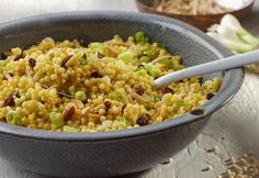 Israeli Couscous Salad Israeli couscous cooked in a combination of curry powder and a savory vegetable broth. Israeli Couscous Salad, Couscous Salad Recipes, Barley Salad, Farro Salad, Spicy Almonds, Toasted Almonds, Mediterranean Couscous, Vegetable Recipes, Vegetable Stock