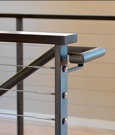 Metal & stainless cable stair rail detail.