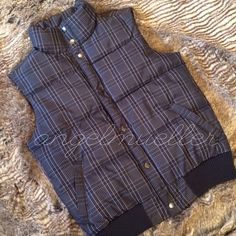 """Black and gray plaid puffer vest This puffer vest is super cute, black and gray plaid, snaps down the front, two pockets in the front. Length: 24"""", bust: 21"""". Perfect condition. This item is used and may have imperfections. Merona Jackets & Coats Puffers"""