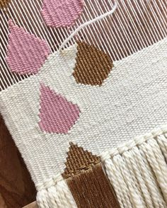Pink and gold raindrops on the loom