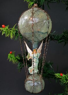 1880-1890, 18 cm high.//angel standing on orb