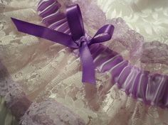 Lacy  lavender satin Wedding Garter -  long Light pink lace ruffle with lavender lace trim - purple ribbon -   By Victoria Joanne. $9.00, via Etsy.