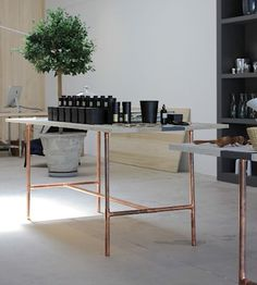 I like the concrete table top and copper piping. hmm. i would like to make something like this.