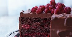 Chocolate-Raspberry Cake---This beauty is baked with a splash of Chambord and layered with a sweet raspberry filling, both of which offer bright counterpoints to the thick layer of chocolate-cream cheese frosting and whole berries scattered on top. Food Cakes, Cupcake Cakes, Book Cupcakes, Chocolate Raspberry Cake, Decadent Chocolate, Delicious Chocolate, Cake Chocolate, Chocolate Recipes, Rasberry Cake