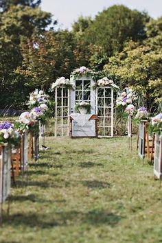 vintage doors are so in right now. Top them off with flowers to make your wedding stand out!