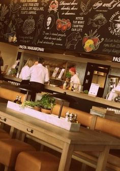20 Best London Lunch Spots // Vapiano is a pizza, pasta and antipasta restaurant ... each diner is given a card to charge their order to - makes the billing process light work. Pasta, pizzas, antipasti and salads are ordered directly from chefs at the individual stations in the restaurant. There's also mini herb gardens that line the long wooden tables for you to pick from and add to your meal.
