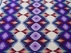 From the book: This lush afghan steals its look from needlepoint. Work the beautifully colored flame shapes in three panels of afghan stitch.