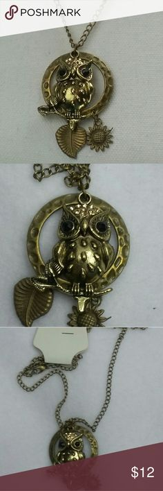 """Owl long chain Pendant necklace brass This is an adorable Owl Pendant with a leaf and sunflower accent chain is approximately 28"""" , brass color metal.  (500010) Fashion Jewelry Jewelry Necklaces"""