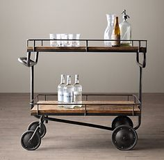 This is the New Warehouse Trolley Bar Cart (from Restoration Hardware). Mine is shiny chrome, but I like the idea of adding a rough wood serving piece to work the modern against the rustic...