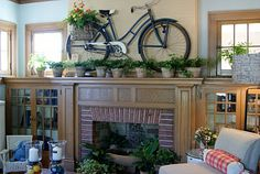 how creative! they used a bike as decor on their fireplace mantlepiece