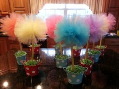 Truffula trees for my Dr. Seuss themed classroom. Made with tulle pompoms, electrical cable, and $1 store pots.