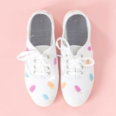 Find out how you can use fabric paint and a simple three-part shape to add cute popsicle silhouettes to a pair of white canvas shoes.