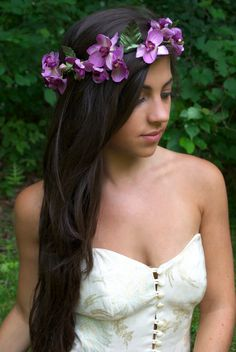 Long dark hair and a purple flower crown