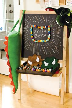 Themed photo booth - kids can dress up as the program theme.  (This case, dinosaurs.)