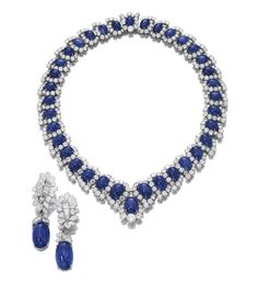 Important Sapphire and Diamond Necklace and a Pair of Ear Clips by Bulgari. Rome. The Necklace Has a Graduated Row of Cabochon Sapphires Framed by Brilliant-Cut Diamonds {Length Approx.410mm}. Fitted Case Stamped Bulgari Roma. Pendent Ear Clips Each with a Detachable Cabochon Sapphire Suspended from a Surmount of Foliate Design Set with Marquise-Cut, Brilliant-Cut and Baguette Diamonds. Circa 1965. Sold 2012 Sotheby's Auction for US$510,000