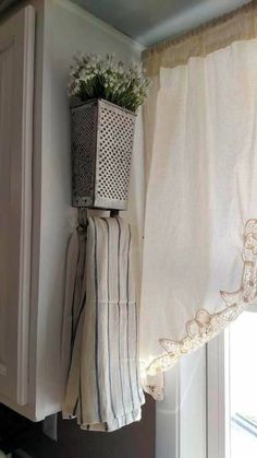 Vintage grater - re-purposed for towel holder and flower planter. Great idea for farmhouse kitchen decor.