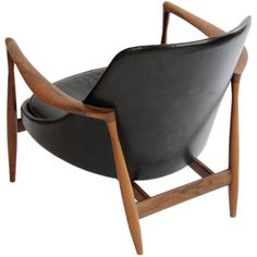 Rosewood Elizabeth Chair by Ib Koford-Larsen  Denmark  1950's  A Elizabeth chair by Ib Koford-Larsen in Rosewood. The chair is untouch from it's original purchase. The frame is a handsomley grained rosewood.