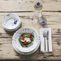 Kay Bojesen Grand Prix dinner fork and dinner knife polished. Royal Copenhagen plates and bowls.