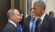 Russian President Vladimir Putin speaks with President Obama in Hangzhou, China, on Sept. 5, 2016. (Associated Press)
