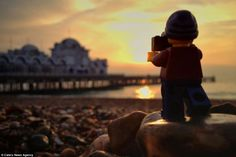 By the seaside: Leg takes a moment to line up a shot of Brighton's famous pier set against...