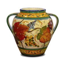 Italian pottery urn hand painted and hand made from Tuscany. Italian ceramic vase with grape and grape leaf pattern.
