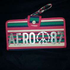 Striped Aeropostale Wallet!! Colorful striped, pink, purple, green, & white, Aeropostale wallet. New. No tags. Never used! Received as a gift! Aeropostale Bags Wallets