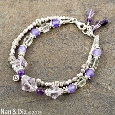 Two strand Karen Hill Tribe silver bracelet amethyst by NanandBiz  This two-strand Karen Hill Tribe silver and amethyst bracelet offers a generous taste of high purity antiqued silver in a trendy style just right for stacking. Rose de France amethyst, prasiolite, hill tribe silver, sterling silver. $42.00