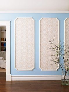 Framing wallpaper in decorative molds adds a luxe look to a large wall. #DIY #crafts #decorating
