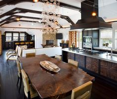 Wood work on the front of the island - 15 Stylish Wood Furniture And Features With Natural Edge Abundance of Natural Light - Coastal-Inspired Kitchens and Dining Rooms on HGTV