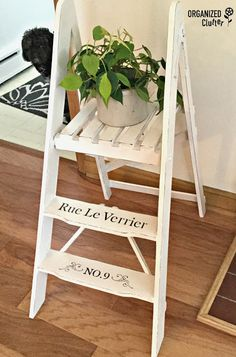 Organized Clutter: Garage Sale Step Ladder Style Plant Stand Makeover