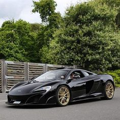 Full black on gold wheels,yay or nay? #mclaren #675lt #lovecars 📷@purepowerphotography #tagforlikes #driver #vehicle #F4F