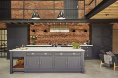 Industrial style shaker kitchen painted in charcoal grey against an exposed brick wall and featuring lots of original features. Kitchen by Tom Howley Industrial Kitchen Design, Industrial House, Industrial Interiors, Modern Kitchen Design, Interior Design Kitchen, Modern Interior Design, Modern Industrial, Industrial Table, Industrial Bookshelf