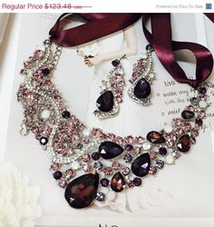 A personal favorite from my Etsy shop https://www.etsy.com/listing/238598473/bridal-jewelry-set-bib-necklace-earrings