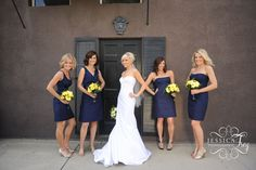 I love all the colors in this picture: navy dresses, tan shoes and bright flowers