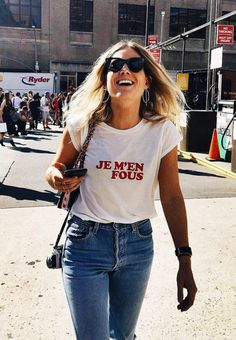 Red and white slogan t-shirt: Lucy Williams in Reformation Je M'en Fous