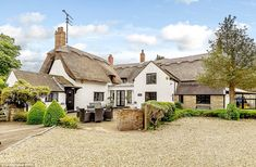 Good enough to eat! This thatched cottage - that is so beautiful it has appeared on the lid of a chocolate box and as a jigsaw puzzle - has gone on the market for £850,000