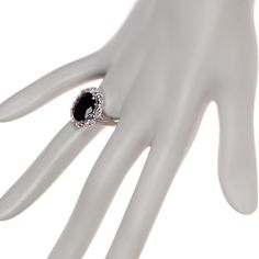NWT Sterling Silver Black Onyx Statement Ring Size 8. Rhodium plated sterling silver. White topaz 1.50 ctw, black onyx 4.00 ctw. Faceted oval-cut black onyx with marquise-cut white topaz halo. Approximately 19mm L x 16mm W ring face. PRICE FIRM Savvy Cie Jewelry Rings