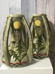 A pair of nouveau Royal Dux style four handled amphora vases.